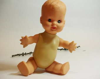 Vintage baby doll. Use for mixed media art, shadow boxes, photography projects,composition, etc.