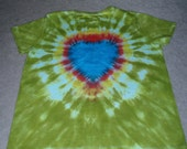 Beautiful blue heart outlined in red and yellow with a background of spring green and baby blue, woman's large t-shirt, super soft