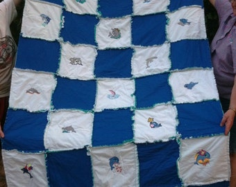 Twin rag quilt with machine embroidered dolphins