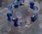 Memory wire bracelet  made with 5 pieces of English sea glass in cobalt, clear and cornflower blue .