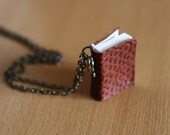Phenomenal Woman by Maya Angelou. Mini book necklace with poem.