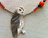 Owl Necklace with Coral, Orange, and Black Beads.