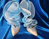 Wedding/evening/dancing shoes.Decorated with ruffles and embroidery.