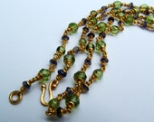22k gold, peridot, iolite necklace...19.""
