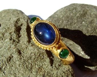 Pailin Sapphire and Sandawana Emeralds 22k gold ring Three stones...