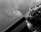 The Boy that Stayed - Signed Archival Fine Art Print - Black and White Photography by Sabato Visconti - Silver Tone Child Portrait in Train