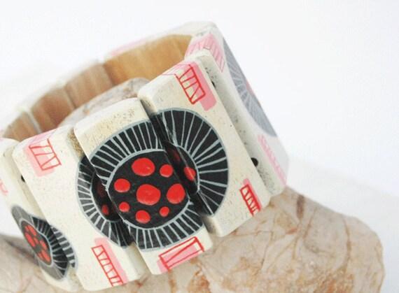 Hand painted bracelet on walnut wood Wearable Art