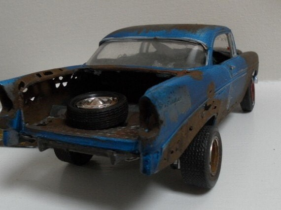1956 Chevrolet 1/24 scale car model in rusted blue