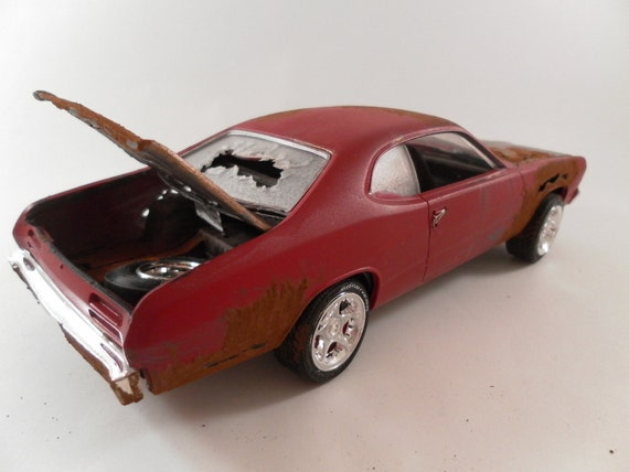 Plymouth Duster 1/24 scale model car in red