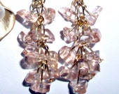 Dangling Rose Quartz wired with gold plated headpins attached to gold plated earwires with tiny pink pearl