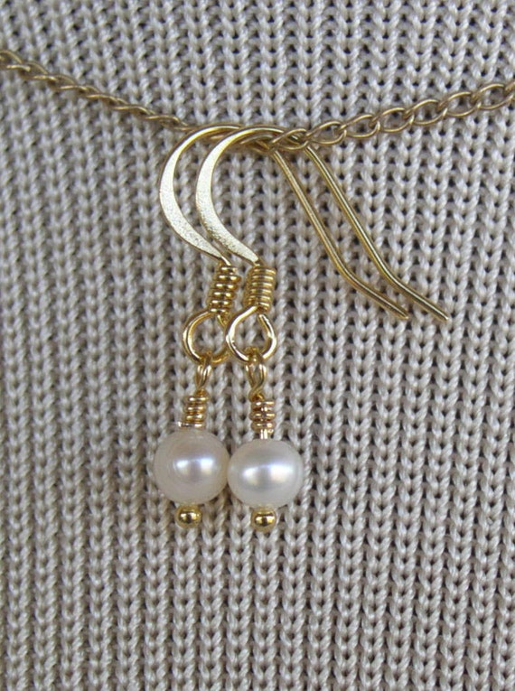 RESERVED Ivory Freshwater Pearl dangles on 14k gold plated ear wires