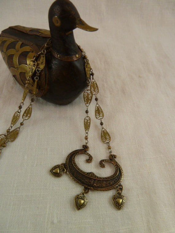 Saqqara Secret Necklace - middle eastern style pendant w/ triple heart dangles in oxidized antiqued brass
