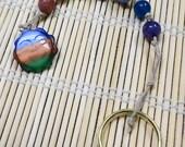 Chakra beaded gemstone cord with multicolored sun pendant