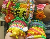KANDI LOT cuffs, singles, necklaces (Custom made order for Jinxx Eyes)