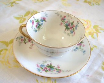 Limoges France vintage floral teacup with delicate pink and blue flowers