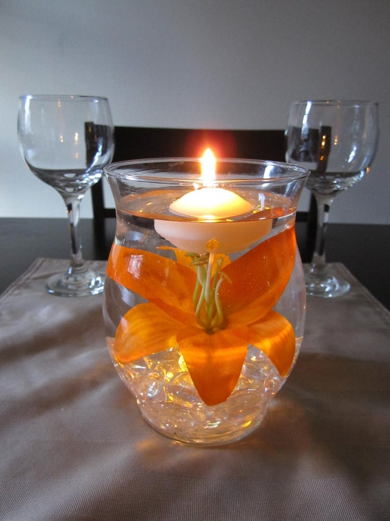 Hurricane vase floating candle centerpiece by roxyinspirations