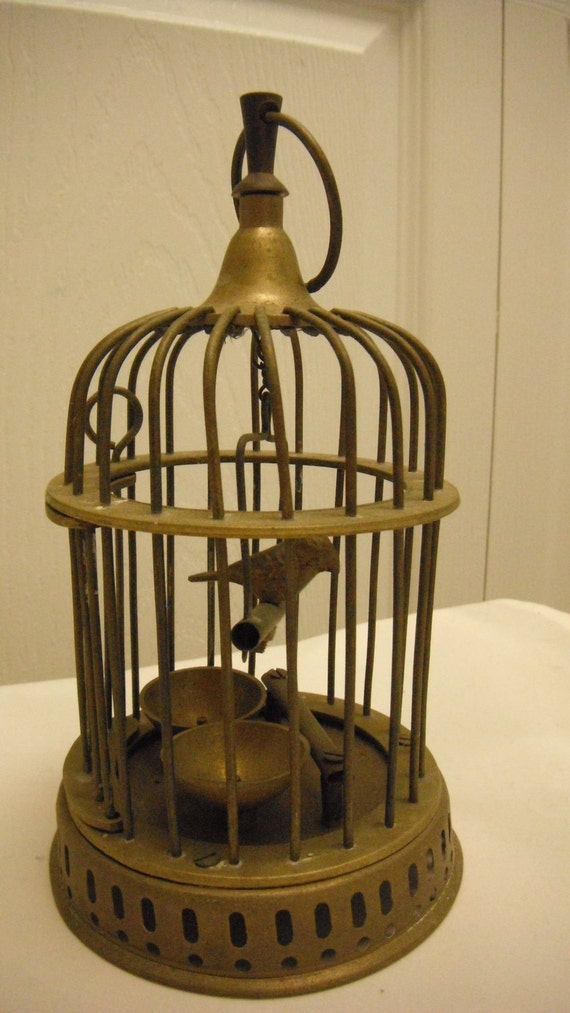 Vtg. Brass BIRD In A BIRDCAGE..8 1/2 in. tall by 11 1/2 in. in diameter..with double feeder..