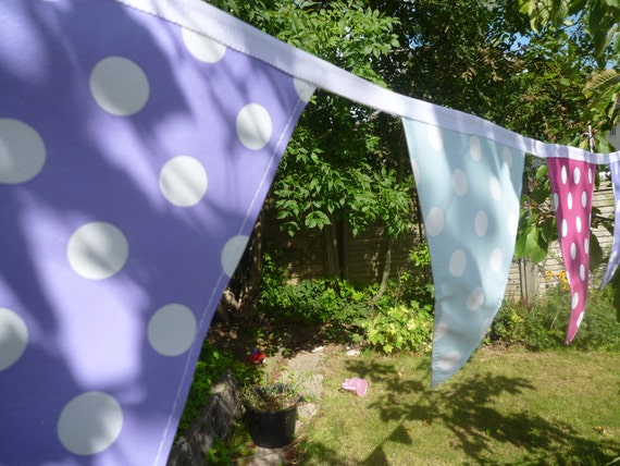 Bunting made with oilcoth for outdoors -blue, pink and purple with white polka dots