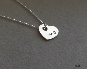 XO hand stamped on a small heart with a heart cut-out in sterling silver (1219)