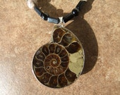 Fossil with clay silver fused beads,onyx,jasper ,pewter ladybugs
