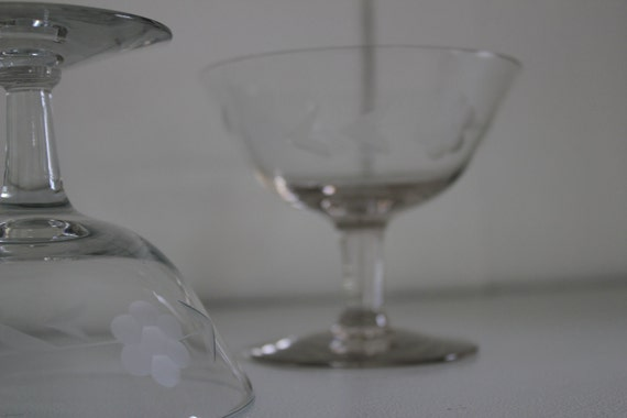 two dainty vintage stemmed glasses or dishes with etching