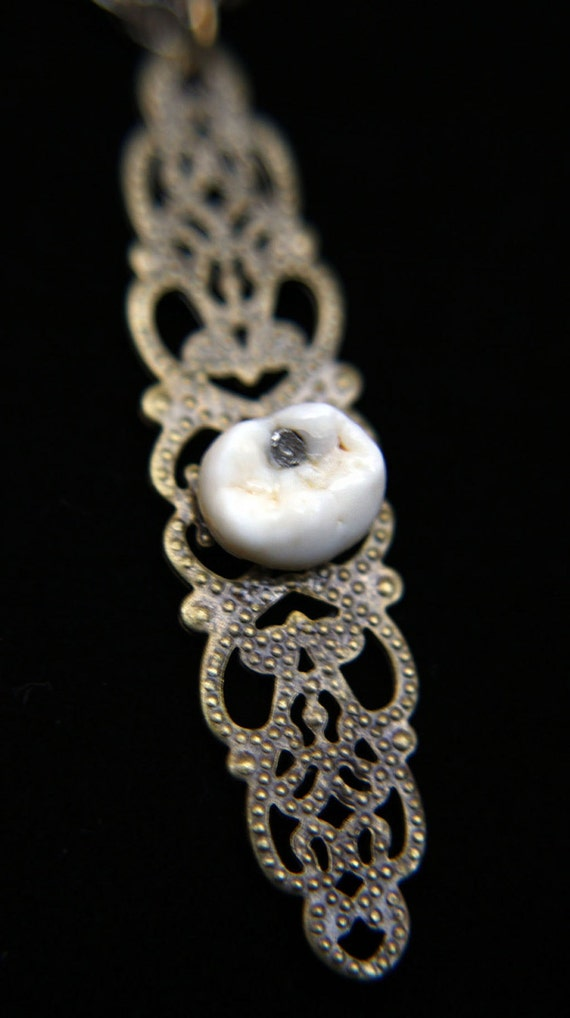 Authentic human tooth with a cavity necklace