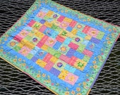 Bright baby girl quilt.  Little Blessings fabrics.  38 x 34 inches