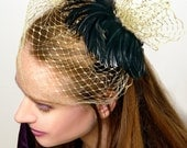 Susette - vintage fascinator style - black feathers - gold birdcage veil.