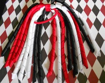 Red, black, and white Korker pony streamer