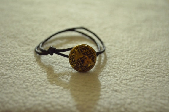 Antiqued Globe Button With Black Cotton Cord Bracelet