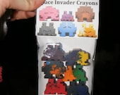 Packet of 6 space invader crayons