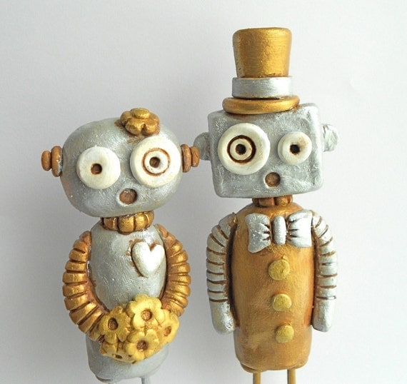 Silver and Gold Robots in Love Wedding Cake Topper as seen in Model Life Magazine