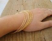 Hand crafted thin bangle bracelets in gold, gold bangle bracelets