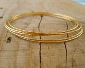 Hand crafted thin bangle bracelets in gold, gold bangle bracelets