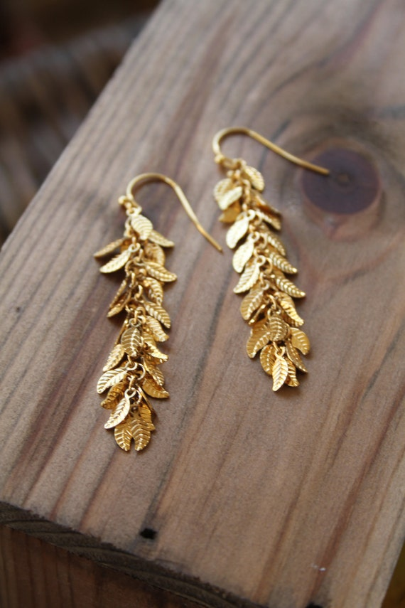 Long gold dangling earrings,Delicate, dangling Goddess-earrings with cascading leaves in gold , gold dangle earrings