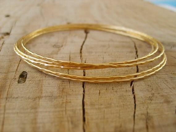 Hand crafted thin bangle bracelets in gold, gold bangle bracelets, set of 5