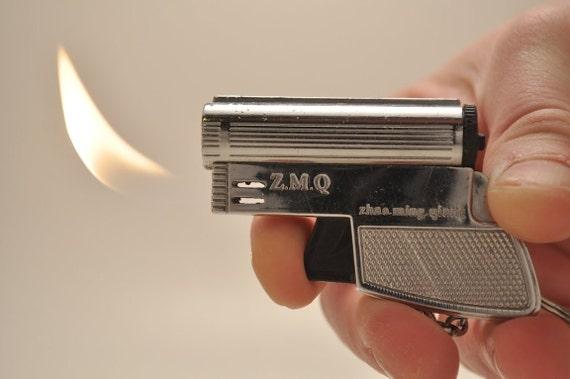 Working Z M Q Butane Gun Lighter Keychain Flashlight
