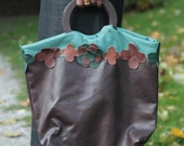 Leather handbag, handmade mixture of brown and turqouise green with a wooden handle flowers around the bag