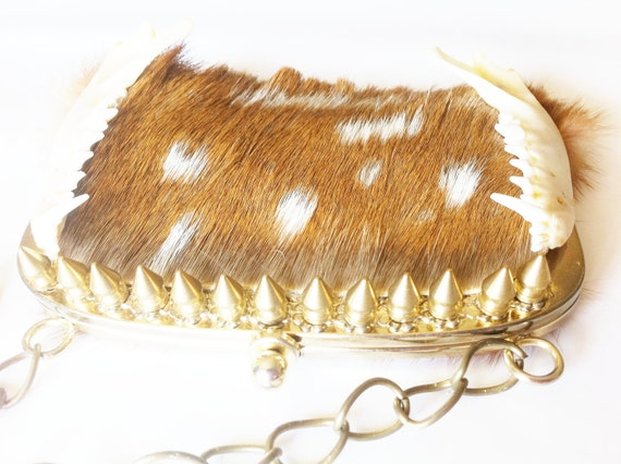 ON RESERVE for lookbookbykindra  taxidermy couture purse with fur, hide, bone, chain, and spikes - HUNTRESS