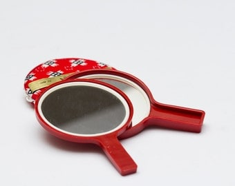 A pair of Japanese nesting mirrors
