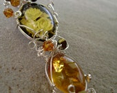 Carved Amber Silver Pendant
