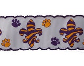 "1.5"" Custom Printed LSU Purple/Gold Fleur De Lis w/ paw prints finished with Purple Moonstitch 5 yards"