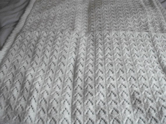 hand knitted baby's blanket in mint green