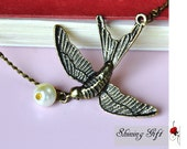 Vintage style Flying bird necklace with a pearl