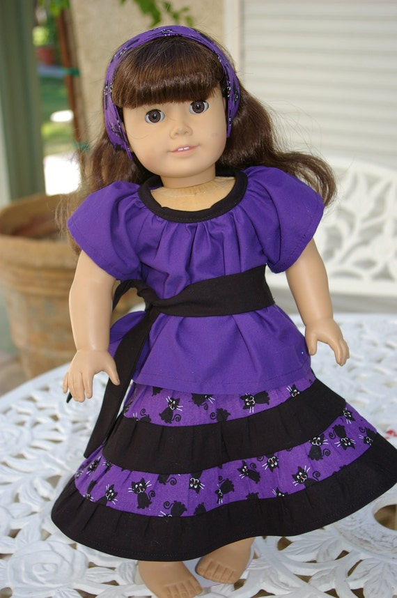 Black cats on purple background skirt and blouse.