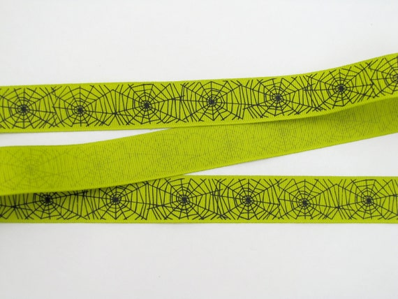 Green ribbon with Spider Webs