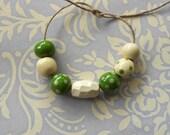 Handmade Ceramic Beads Set in Rich Pea Green and Cream
