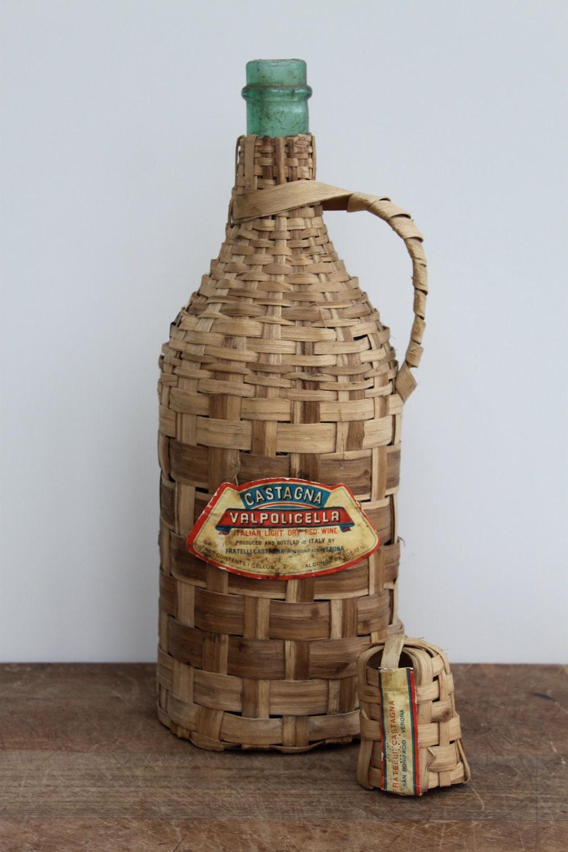 Vintage italian green glass wine bottle encased in a straw for Green glass wine bottles
