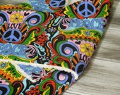the PEANUT POD baby swaddle - a wrap blanket swaddler for newborn, Cozy - Ready To Ship - Peace & Love - blue, green, red, pink, black