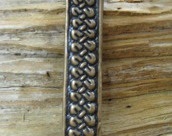 04.165.BZ  Belt  or strap end